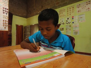 Sri Lanka boy writing