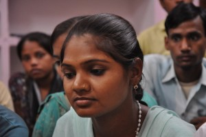 young woman in India sitting
