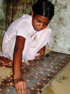 girl making bangles